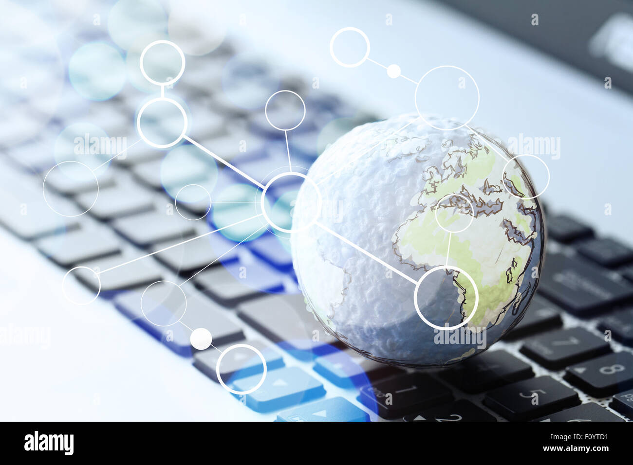 hand drawn texture globe with blank social media diagram on laptop F0YTD1 hand drawn texture globe with blank social media diagram on laptop