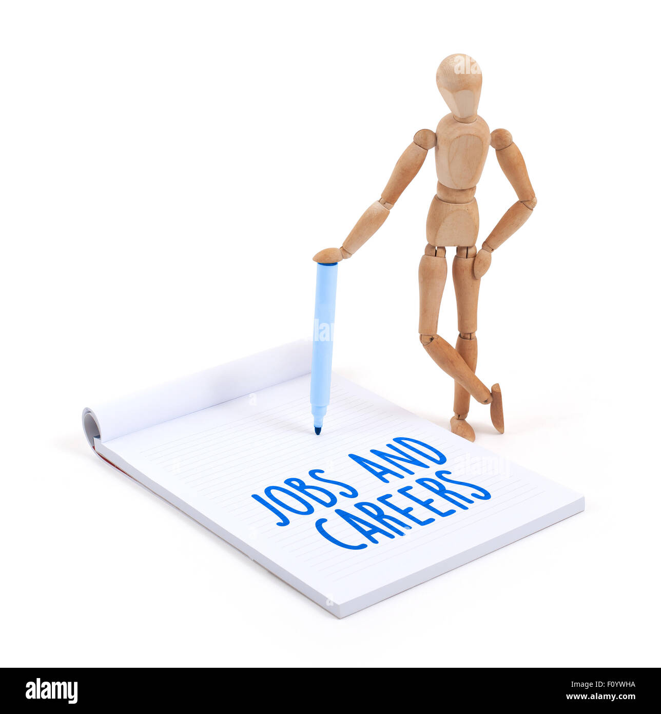 Wooden mannequin writing in a scrapbook - Jobs and careers - Stock Image