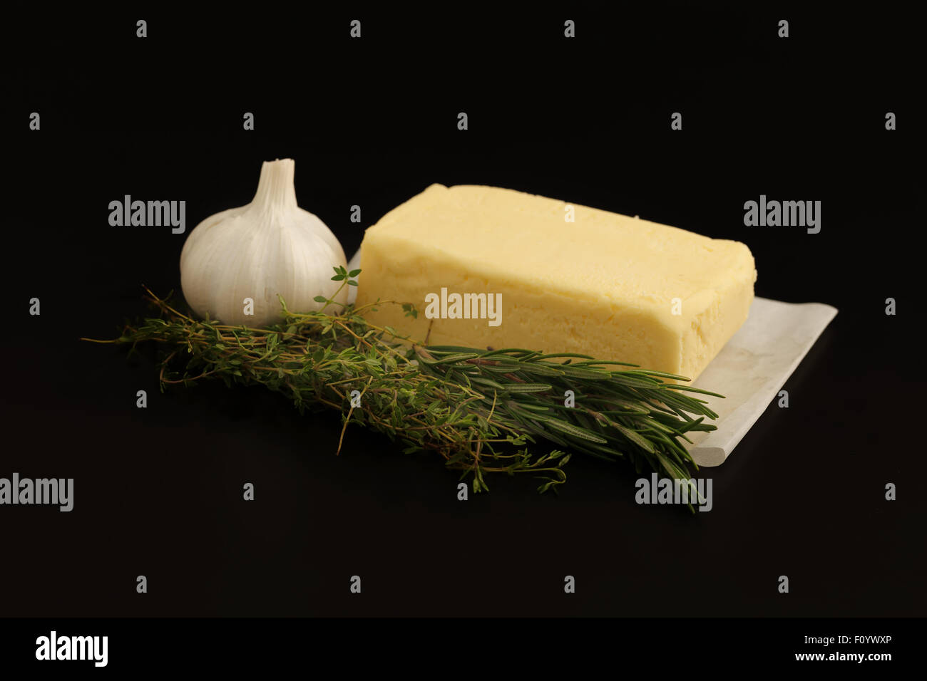 compound butter ingredients herb thyme rosemary garlic fresh homemade italian food tasty - Stock Image