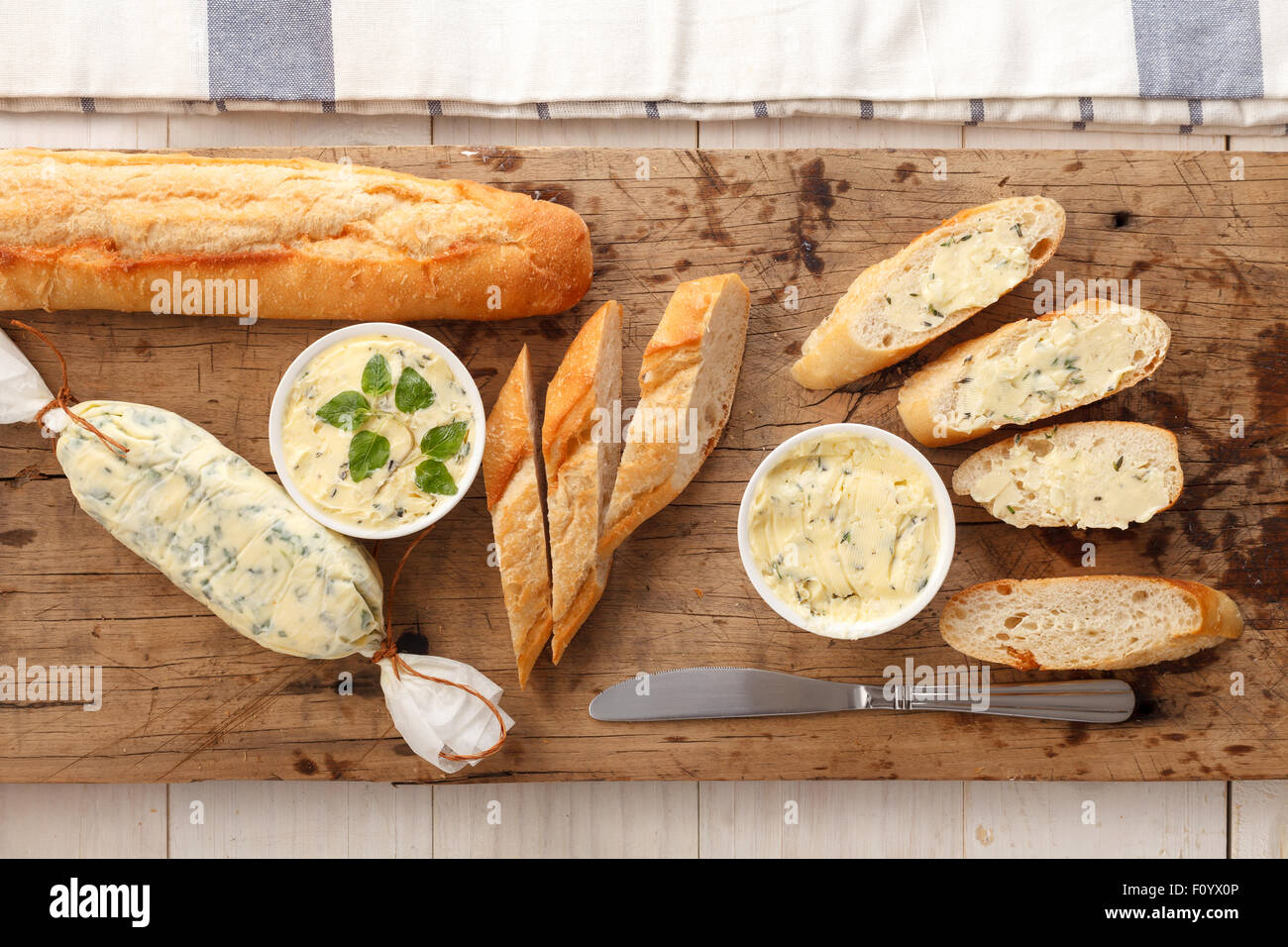 garlic bread compound butter herb baguette thyme rosemary coriander oregano fresh chopped homemade italian food - Stock Image