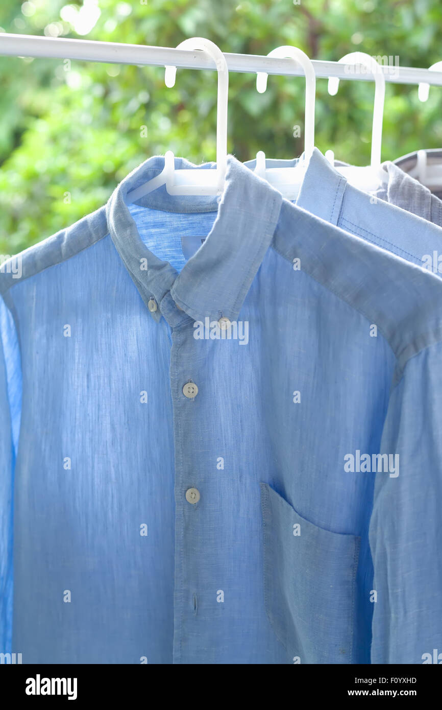 ironing concept housework ironed folded shirts clean still life garment apparel - Stock Image
