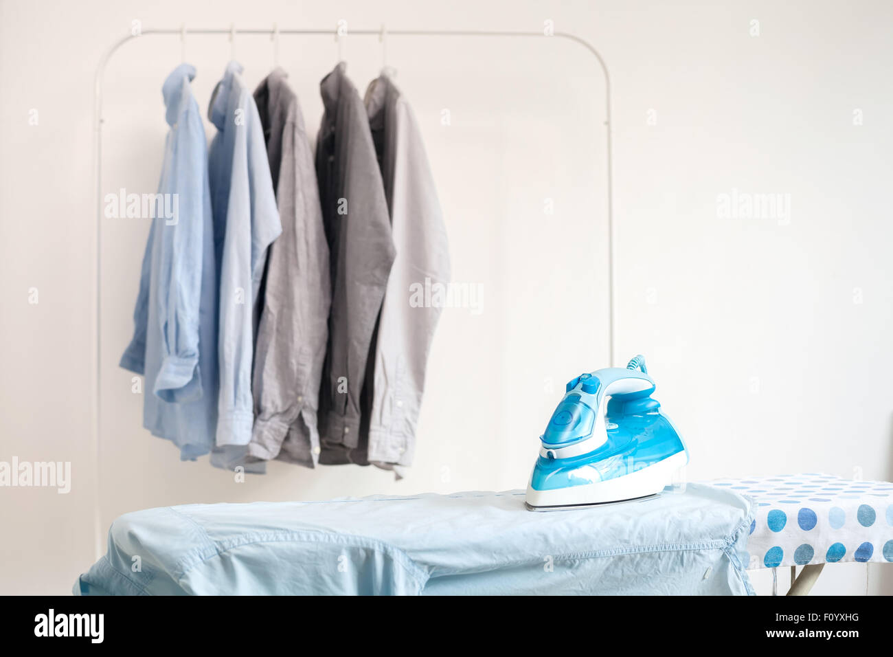 ironing housework ironed folded shirts clean concept still life garment apparel cloth indoors - Stock Image