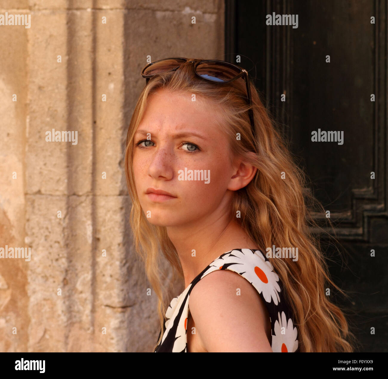 stunning young blonde girl with sunglasses on her head pale complexion. - Stock Image