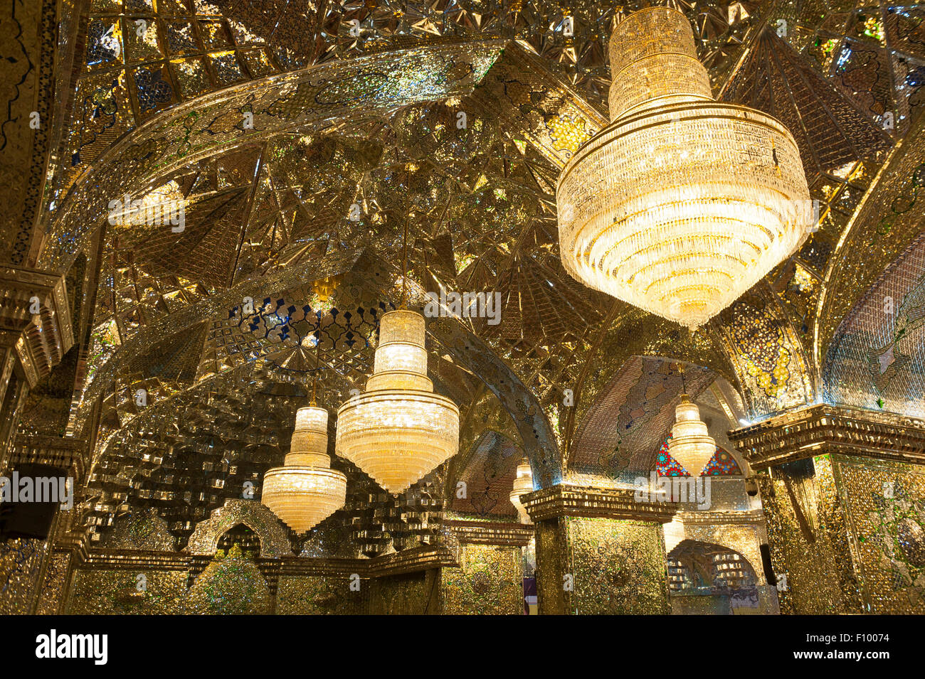 Ceiling of the prayer hall with chandeliers, Shah Cheragh mausoleum and mosque, Cheragh, Shiraz, Iran - Stock Image
