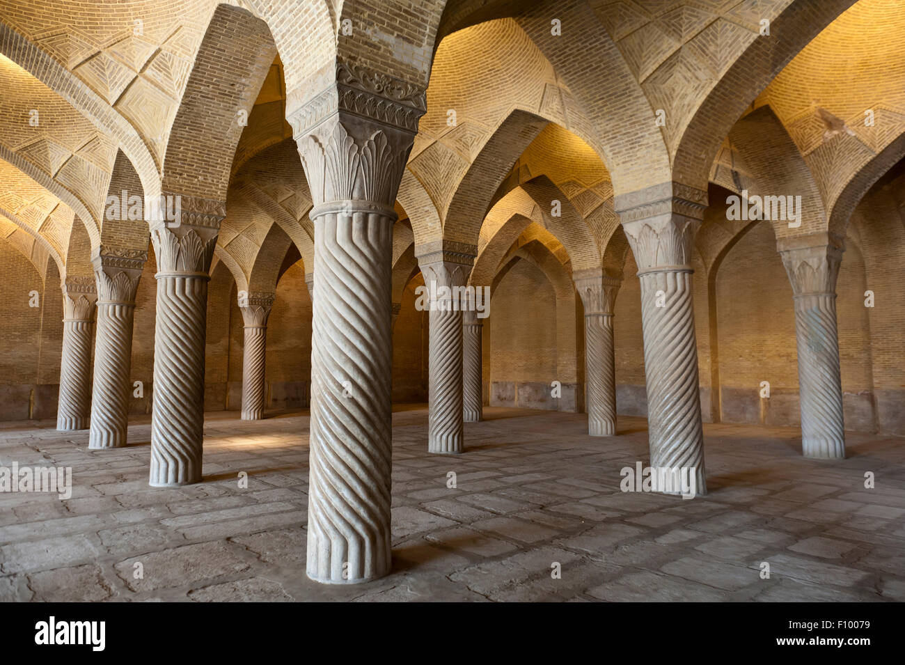 Decorated pillars in the prayer hall, Wakil Mosque, also Vakil Mosque or Masjid-e Vakil, Shiraz, Iran - Stock Image