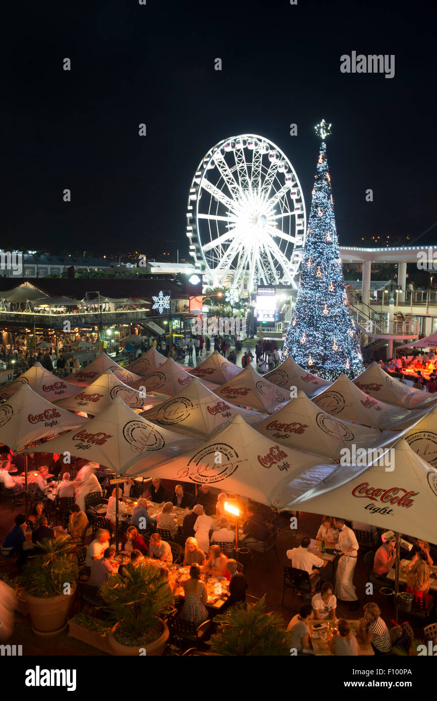 Guests dining at a restaurant,  Wheel of excellence with Christmas tree, V&A Waterfront, Cape Town, Western - Stock Image