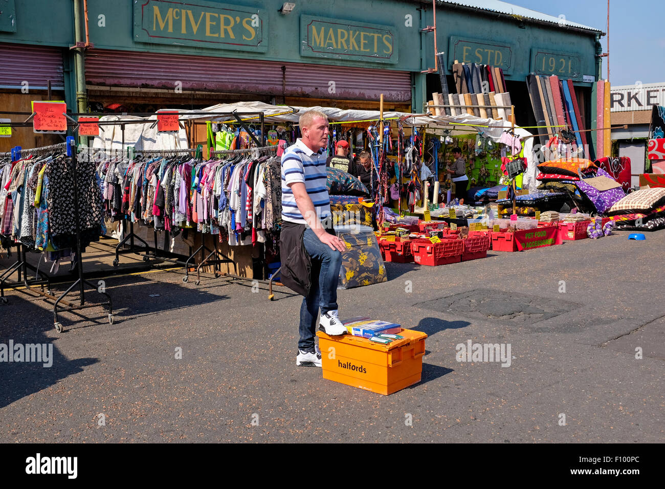 Man selling cheap cigarettes from a box in the street, in the famous second hand market, The Barras, Glasgow, Scotland, - Stock Image