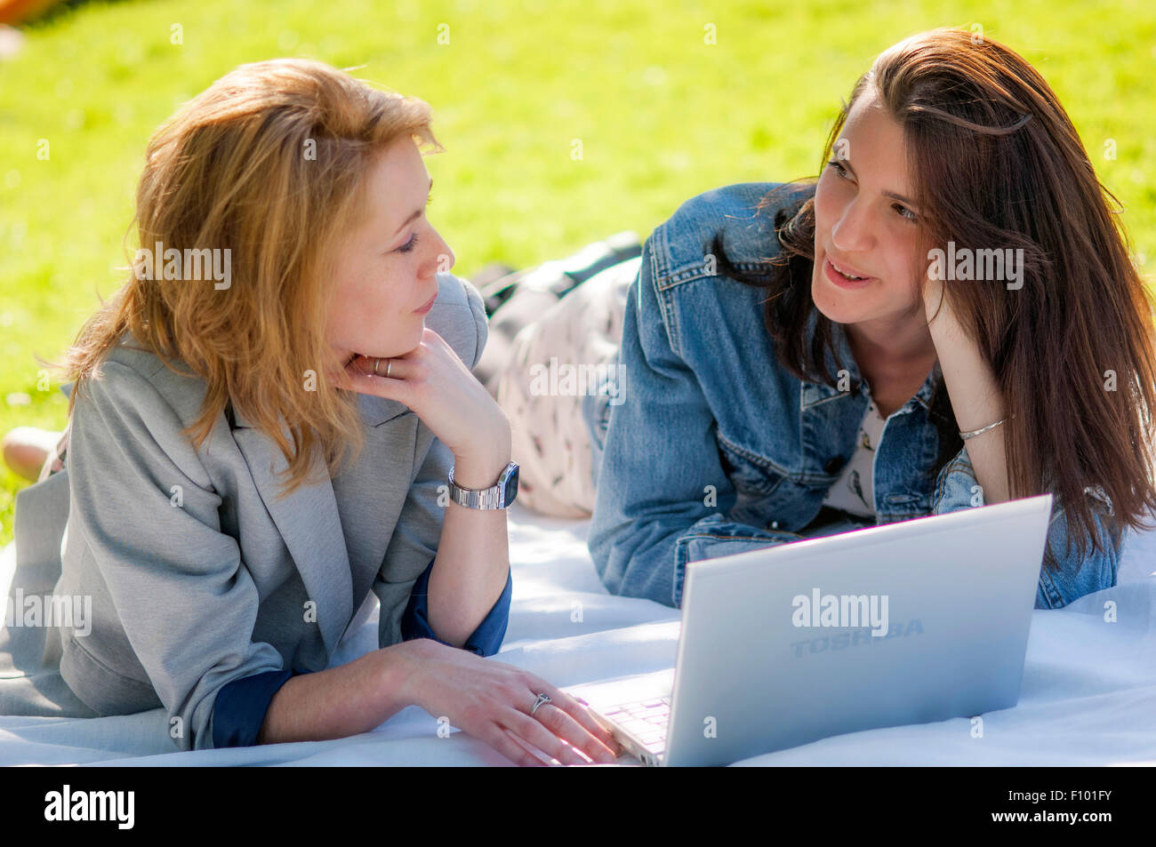 WOMAN WITH COMPUTER - Stock Image