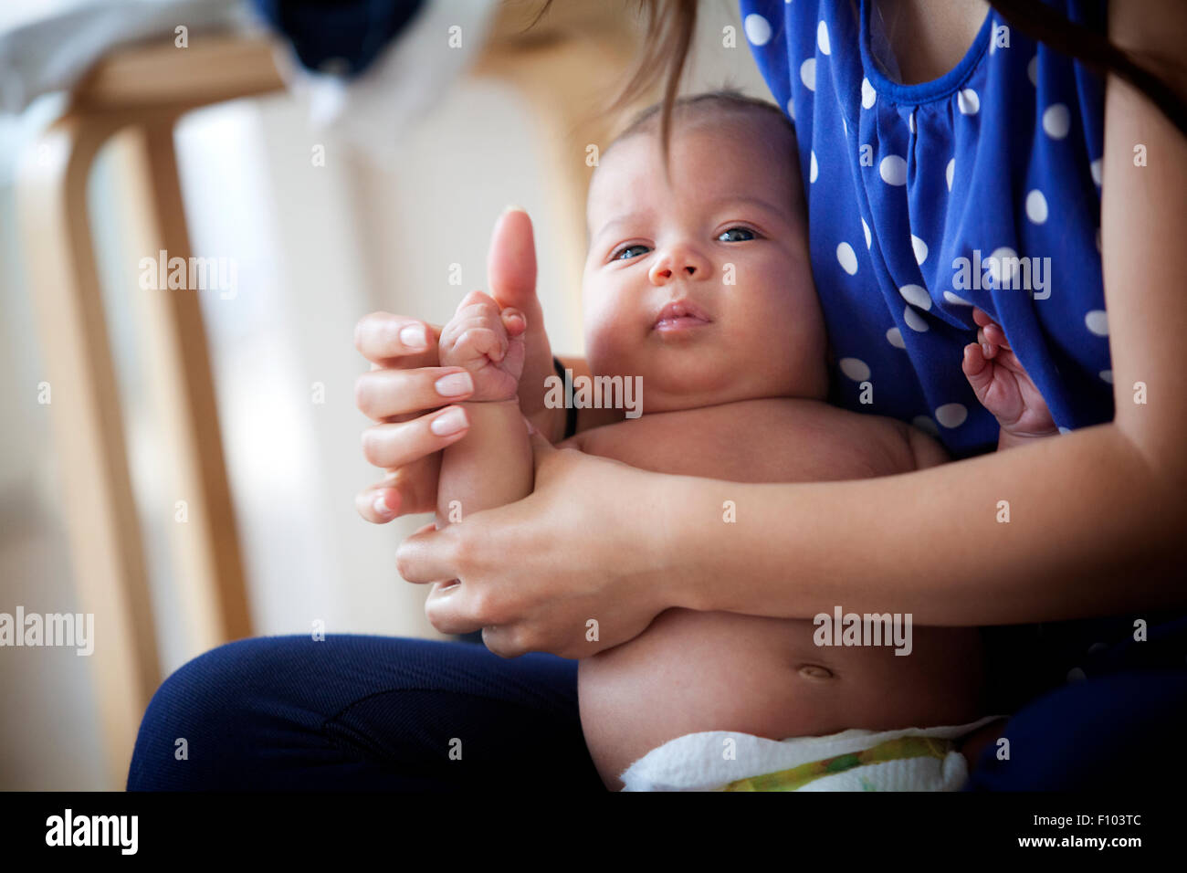 INFANT BEING MASSAGED - Stock Image