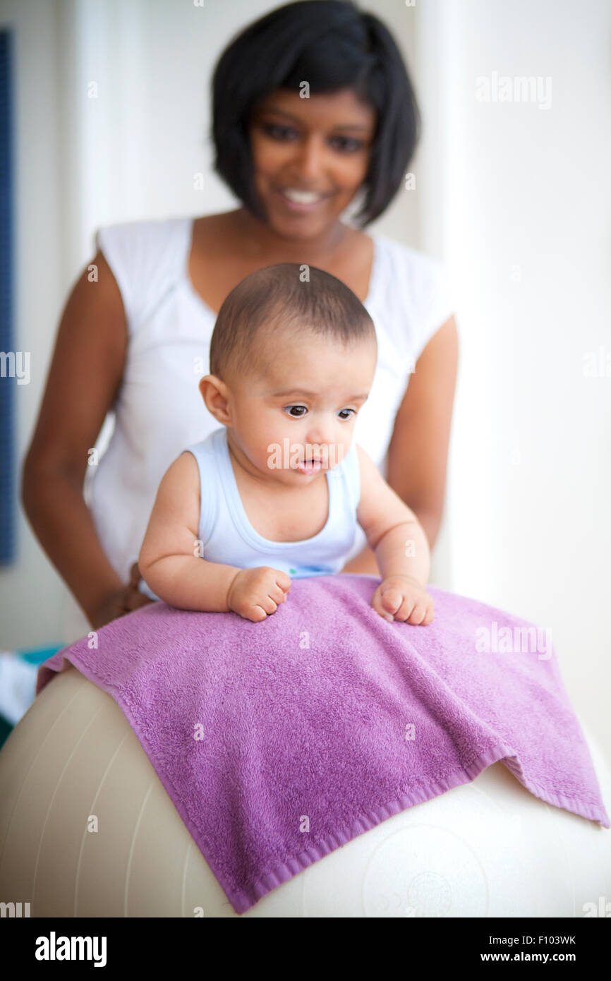 INFANT BEING MASSAGED Stock Photo