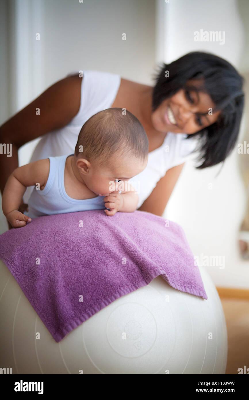INFANT BEING MASSAGED - Stock Image