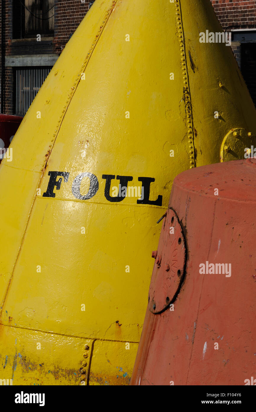 Orange buoy marked with 'Foul'. Purfleet Quay. King's Lynn, Norfolk. UK. - Stock Image