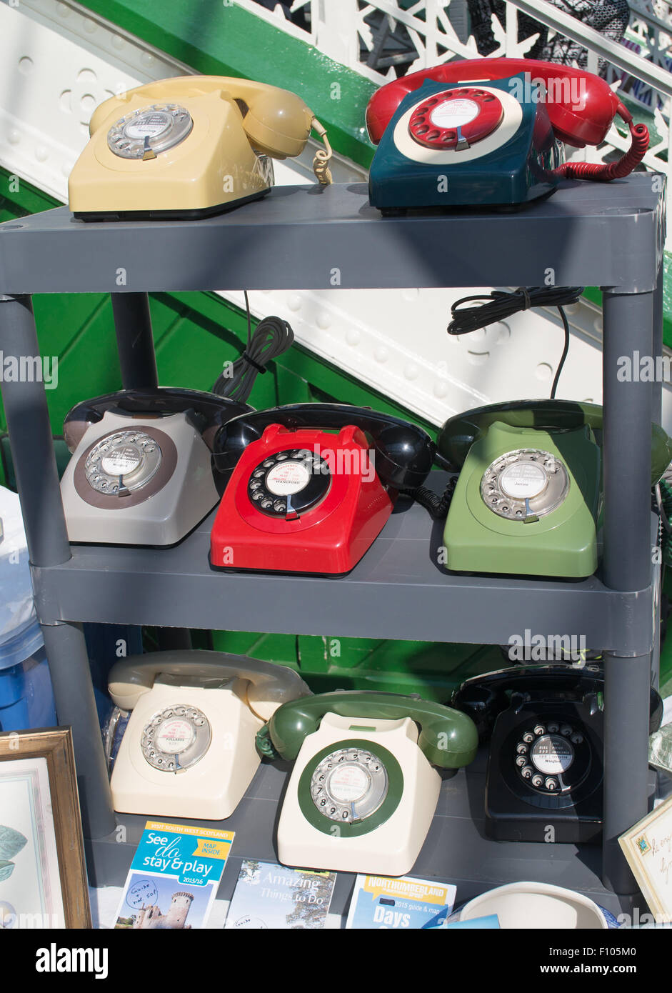 A collection of old dial up analogue phones at Tynemouth Station Market, North Tyneside, England, UK - Stock Image