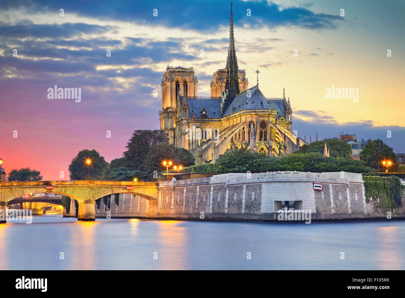 Image of Notre Dame Cathedral at dusk in Paris, France. - Stock Image