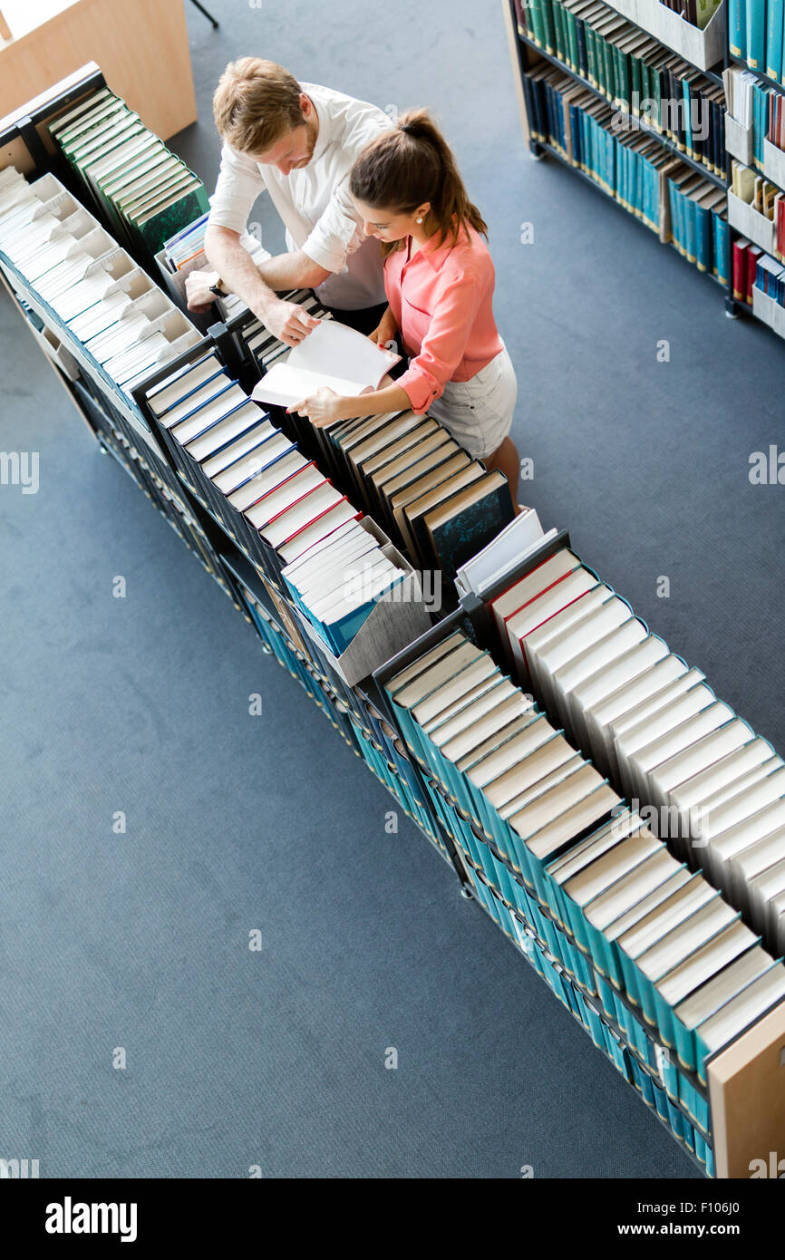 Students learning, reading in the library,view from above - Stock Image