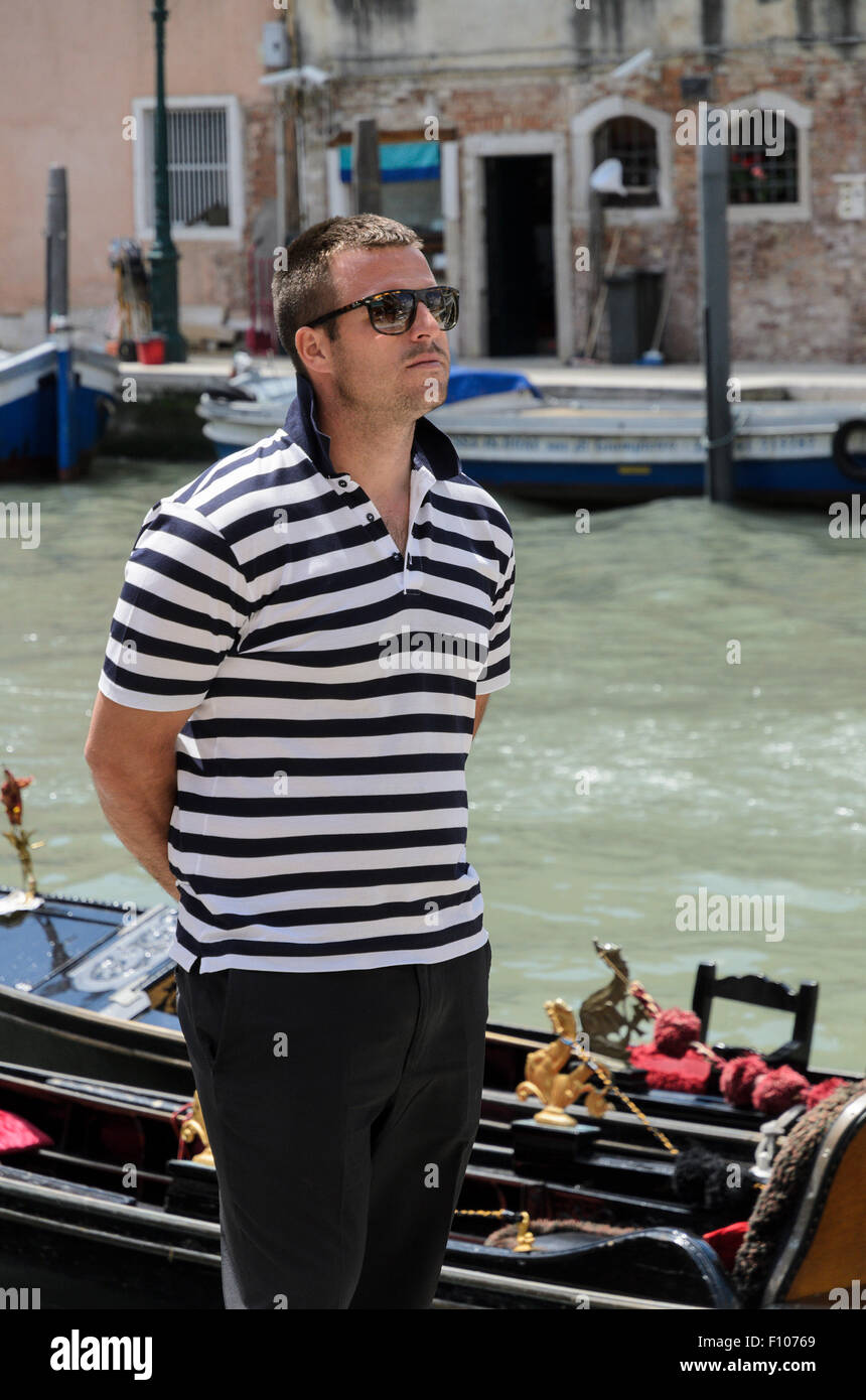 A Gondolier in Venice, Italy, Europe. Stock Photo