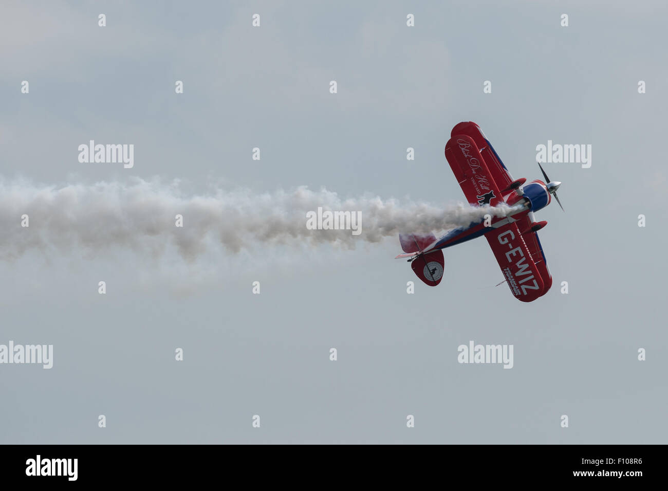 Rich Goodwin's Muscle Pitts Biplane displays at the Dawlish Air Show 2015. - Stock Image