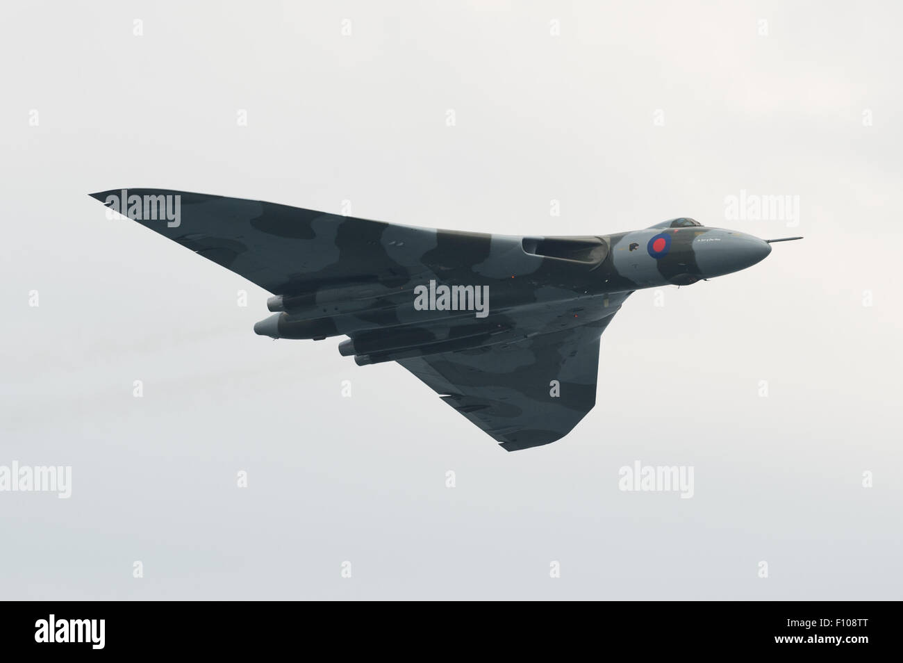 The last airworthy Avro Vulcan V-Force bomber flies for the last time at the Dawlish Air Show 2015. - Stock Image