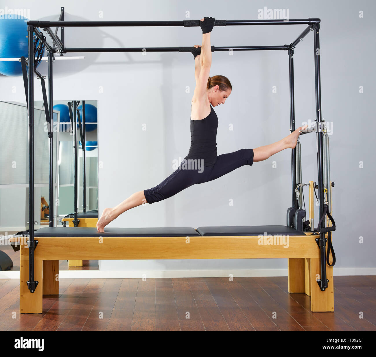 Woman Pilates Chair Exercises Fitness Stock Photo: Legs Split Stock Photos & Legs Split Stock Images
