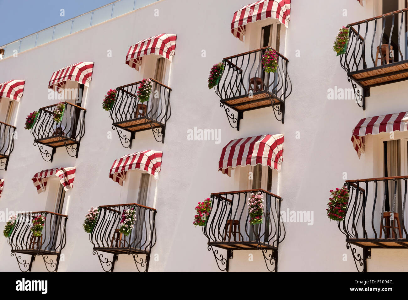 Mediterranean Hotel Balconies with awnings. - Stock Image