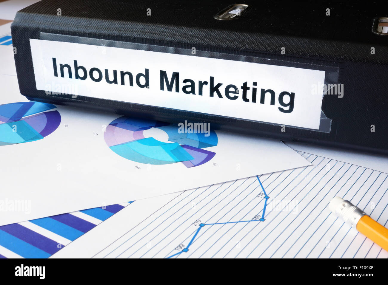 Graphs and file folder with label Inbound Marketing. Business concept. - Stock Image