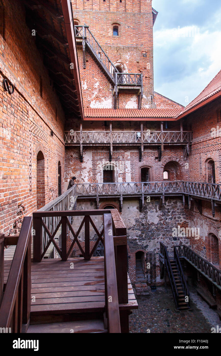 View of brown wooden stairs of Trakai Castle with brown stonewalls. - Stock Image