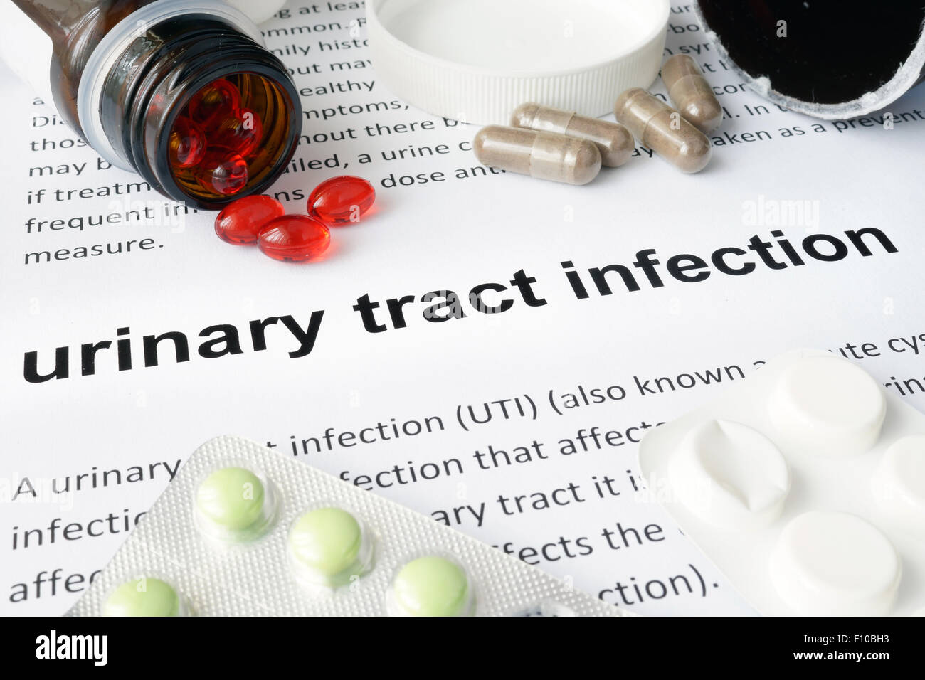 Paper with urinary tract infection  and pills. Medical concept. - Stock Image