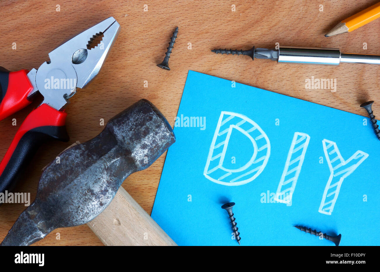 Blue paper with diy do it yourself tools kit on a wood background blue paper with diy do it yourself tools kit on a wood background solutioingenieria Gallery