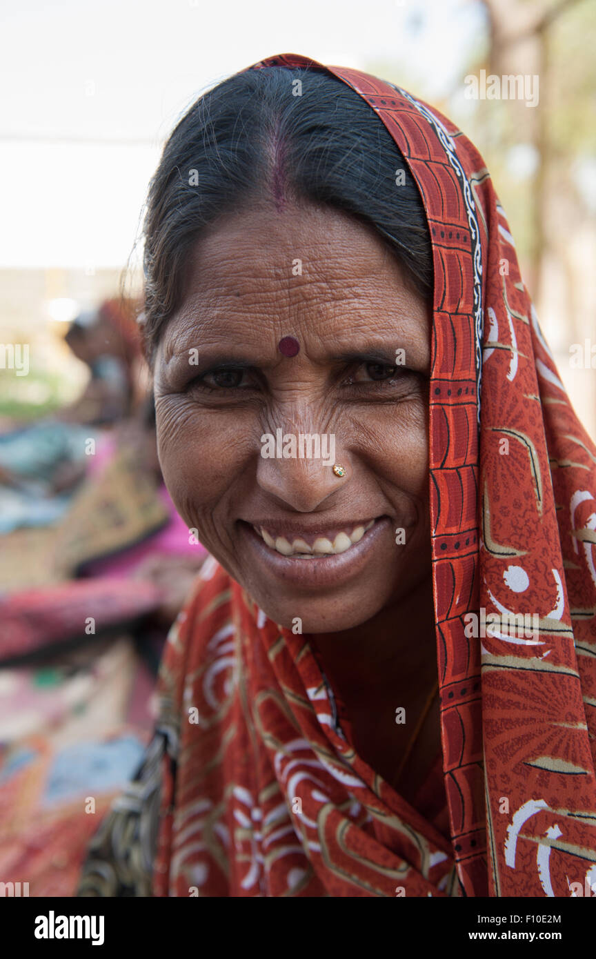 Rajasthan, India. Sawai Madhopur. Smiling local tribal woman with pierced nose and Hindu bindi religious mark on Stock Photo