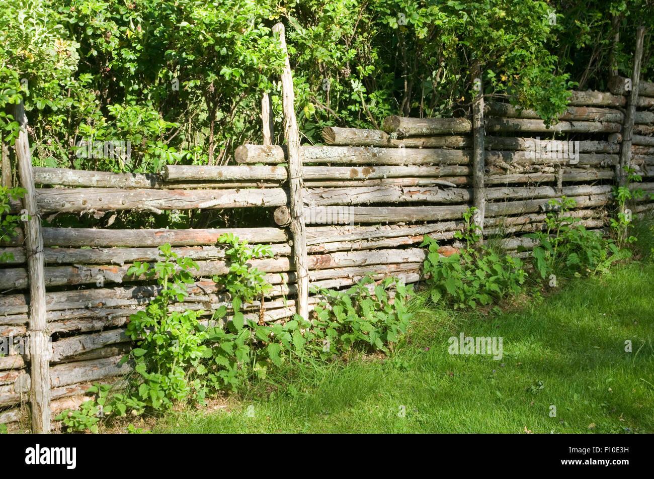 traditional roundpole swedish fence fences fencing sweden countryside round polesweden Scandinavia Scandinavian - Stock Image