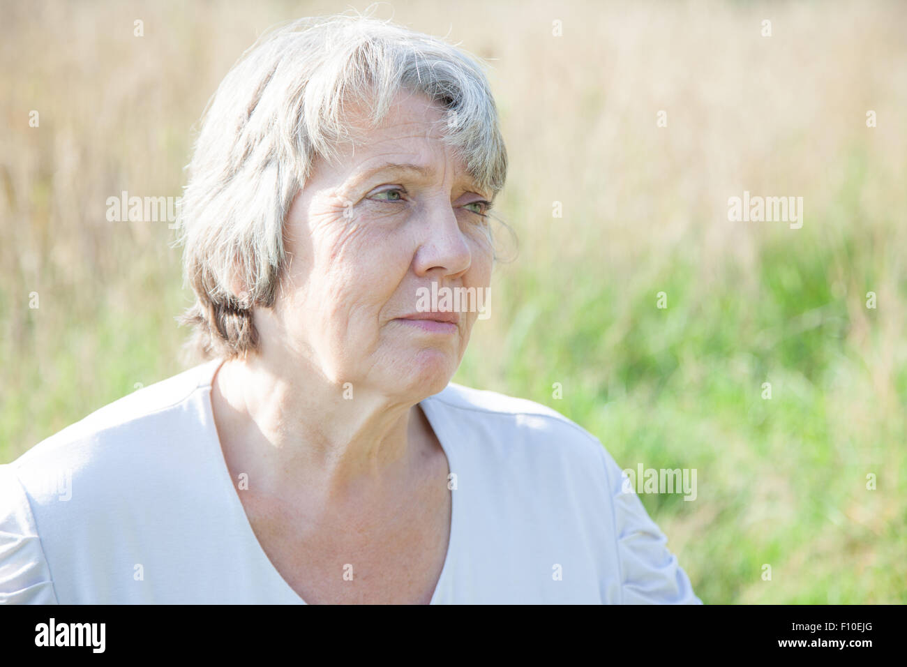 Portrait of a worried old age woman - Stock Image