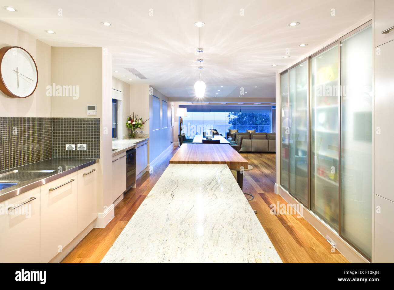 Extra long kitchen island and a table, situated in the middle of a ...