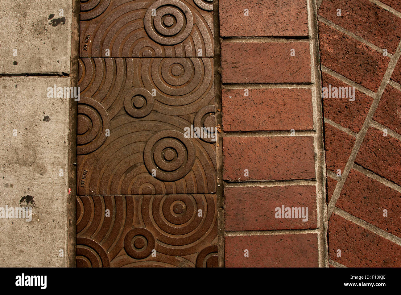 Sidewalk outside of the 24th Street BART station in The Mission, San Francisco, California. - Stock Image