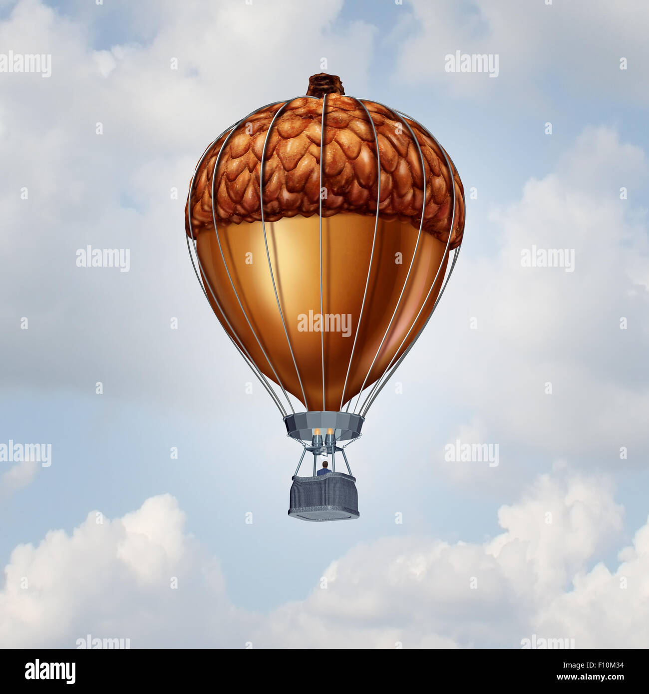 Investment rise and growth concept as an acorn nut shaped as an air balloon as a financial business metaphor for - Stock Image