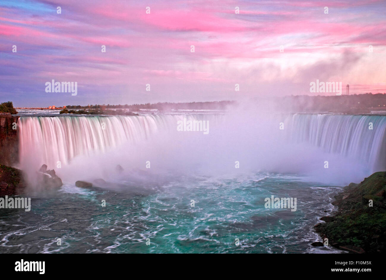 Sunset Clouds over Grand Horseshoe Falls of Niagara Falls at dusk - Stock Image