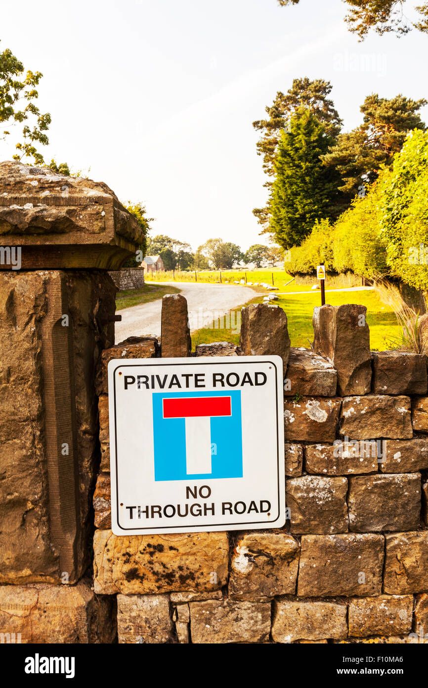 Private road no through road sign on wall drive driveway North Yorkshire UK England - Stock Image