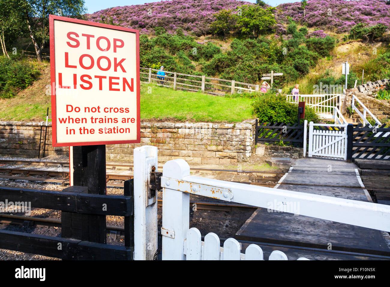 Stop look listen level crossing sign warning rail line railway train trains danger dangerous Goathland North Yorkshire - Stock Image