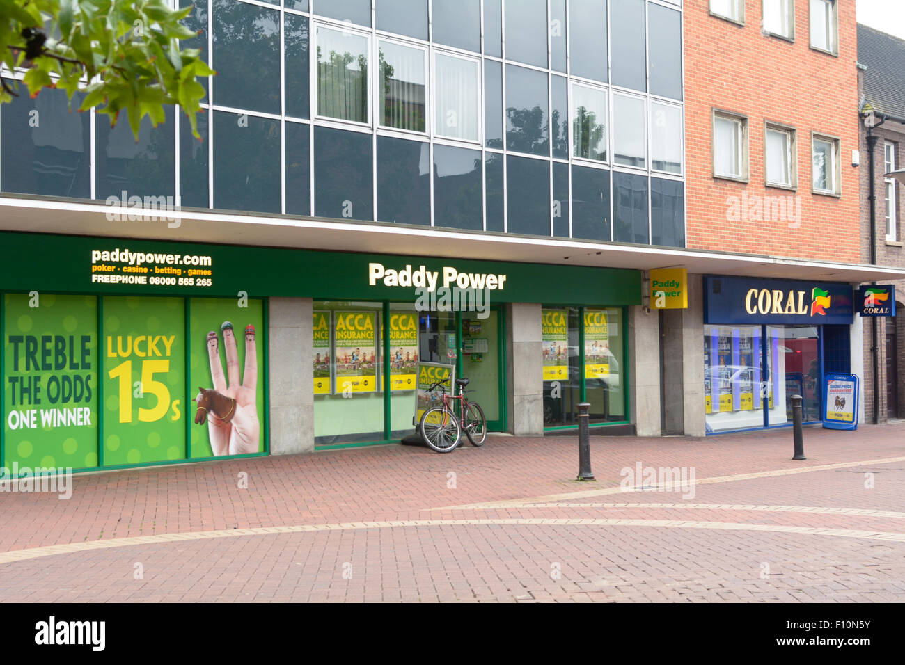 Paddy Power and Coral bookmakers next door to each other in the town centre in Bedford, Bedfordshire, England Stock Photo