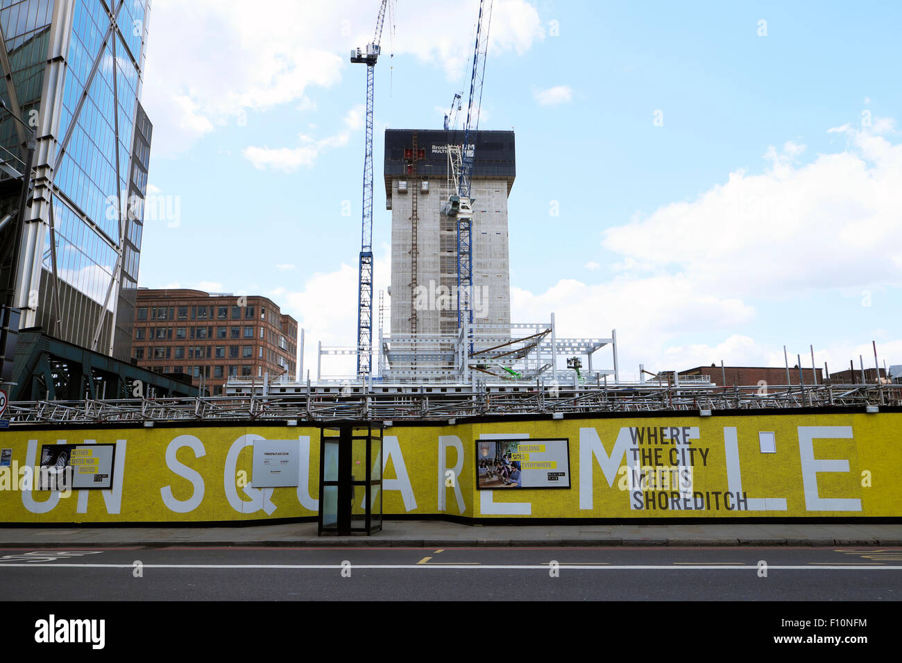 New construction site with building core, cranes and Square Mile hoarding in Norton Folgate, Shoreditch City of - Stock Image