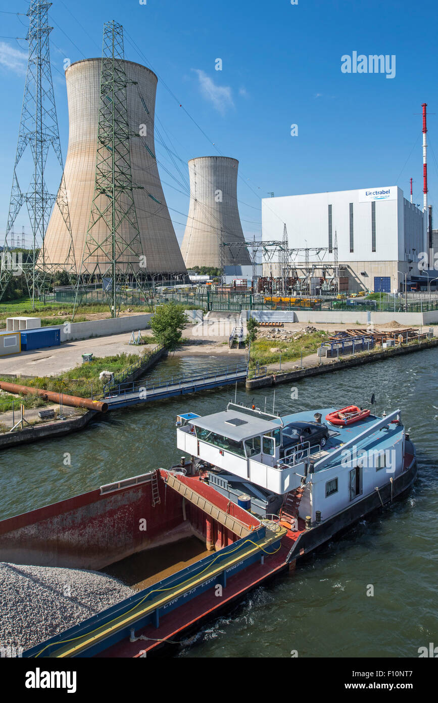 Canal barge and cooling towers of the Tihange Nuclear Power Station along the Meuse River at Huy / Hoei, Liège - Stock Image