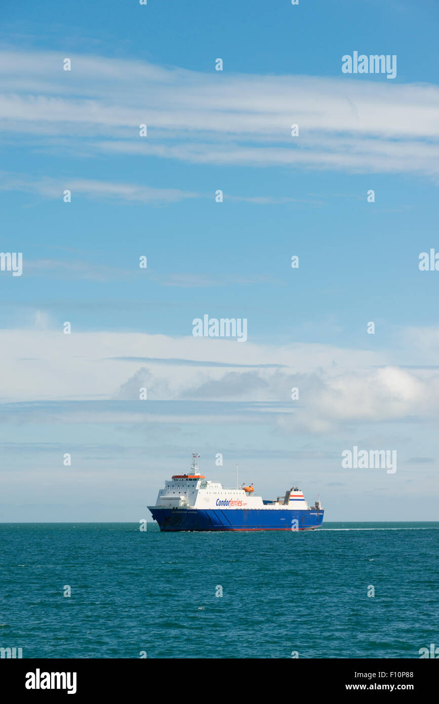 The Commodore Goodwill ferry, part of the Condorferries fleet offshore at the Isle of Wight UK - Stock Image