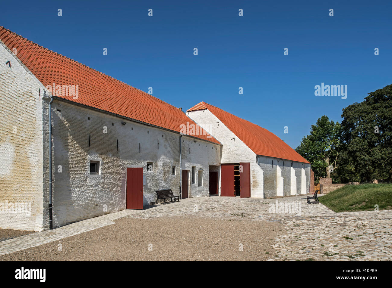 Courtyard showing barns of Château de Hougoumont, where British soldiers faced Napoleon's Army at Waterloo - Stock Image