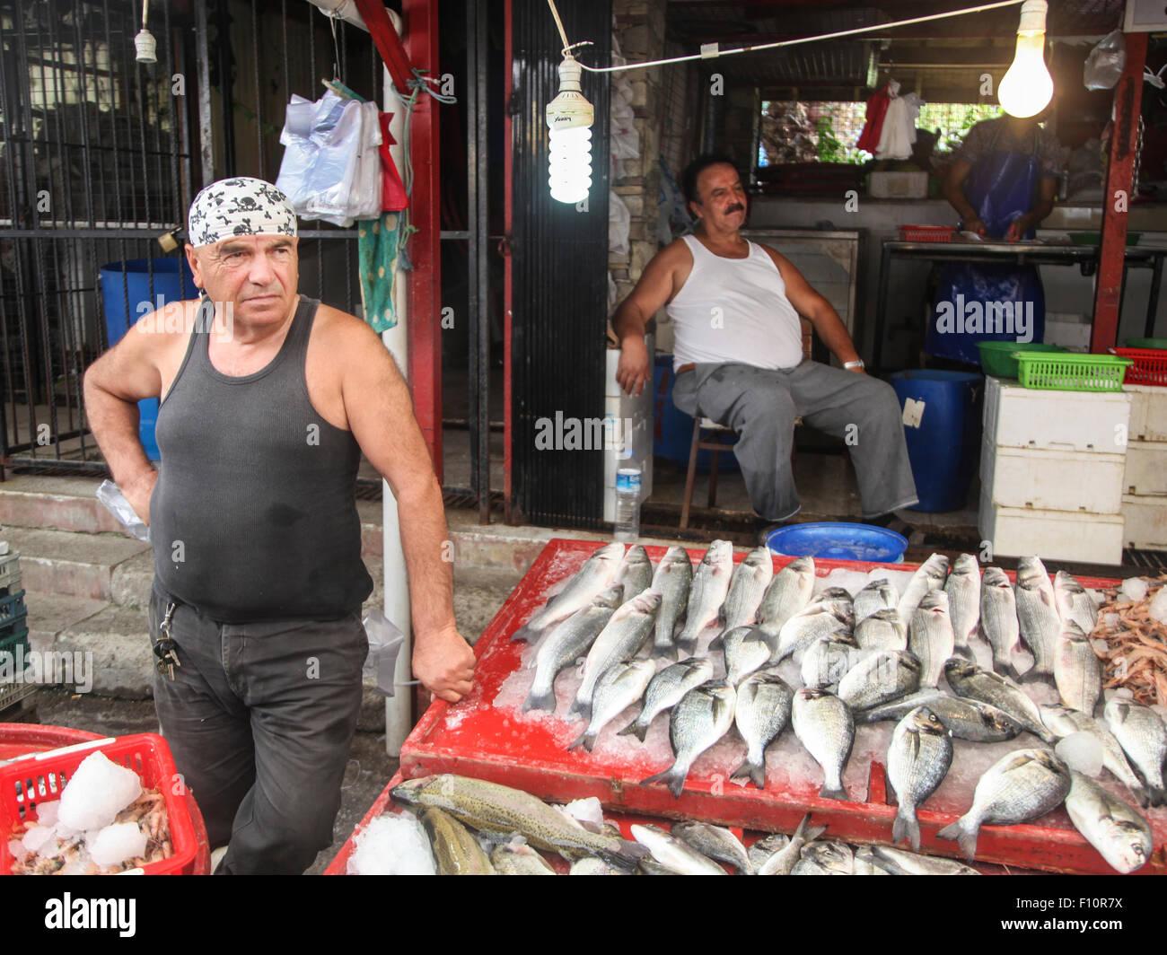 Fisherman on the market in Kusadasi, Turkey - Stock Image