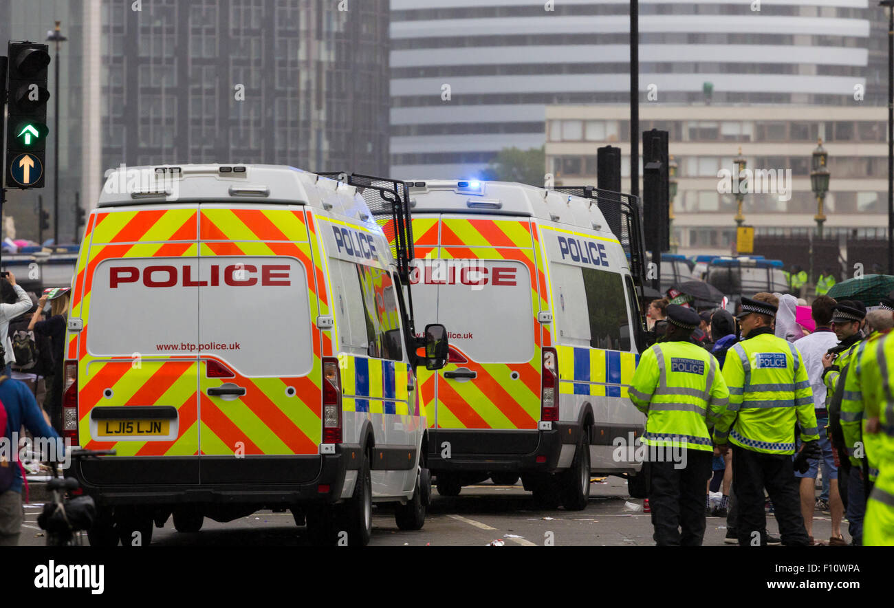British Transport Police public order vans in convoy during a protest - Stock Image
