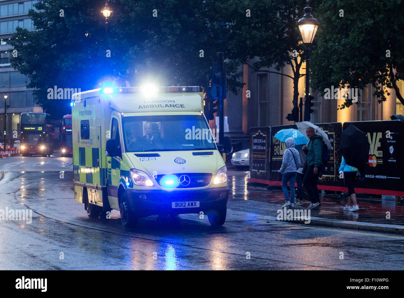 London Ambulance Service responding in bad weather - Stock Image