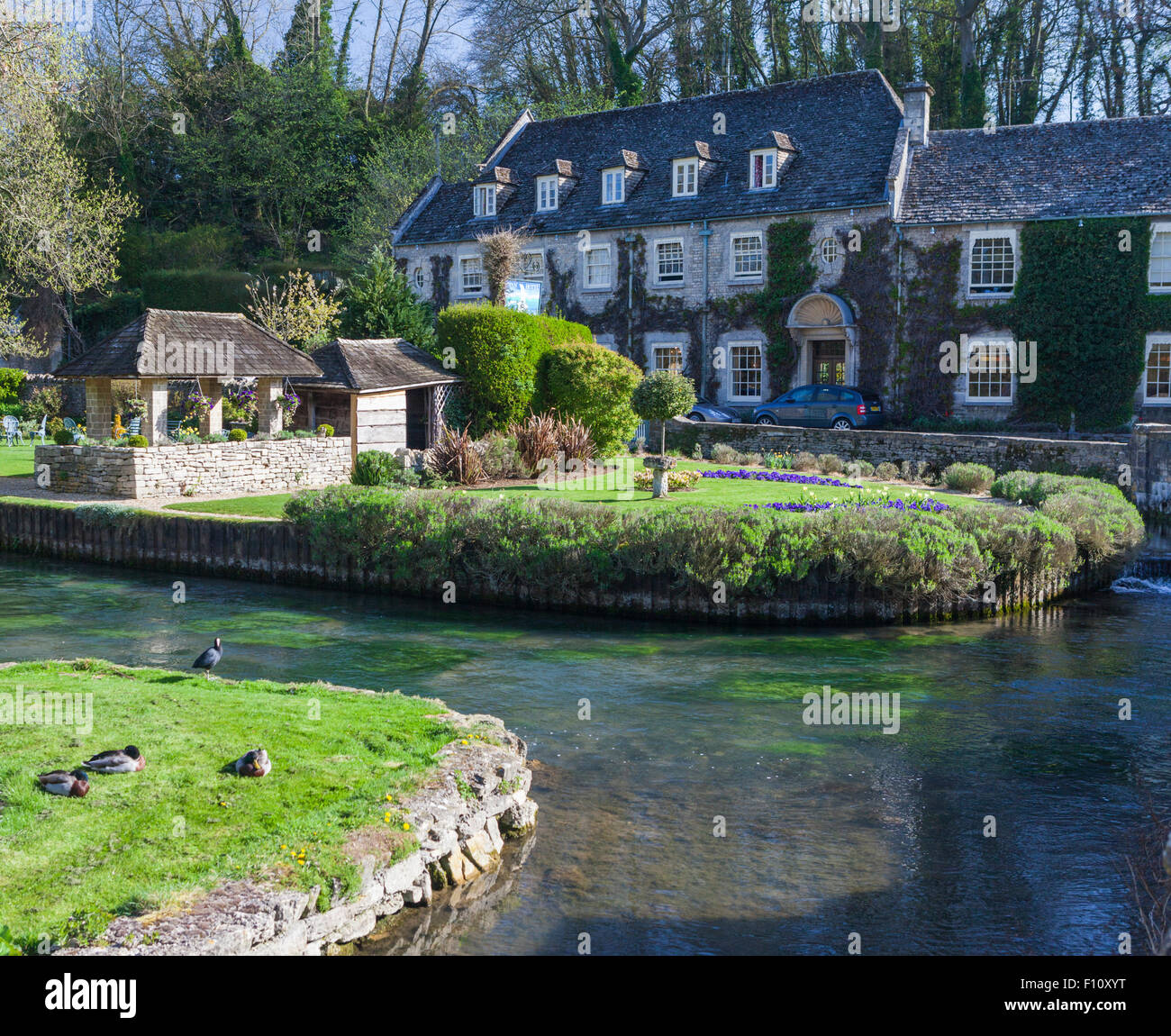 Swan Hotel on the River Coin in Bibury, the Cotswolds, Gloucestershire, England, UK - Stock Image
