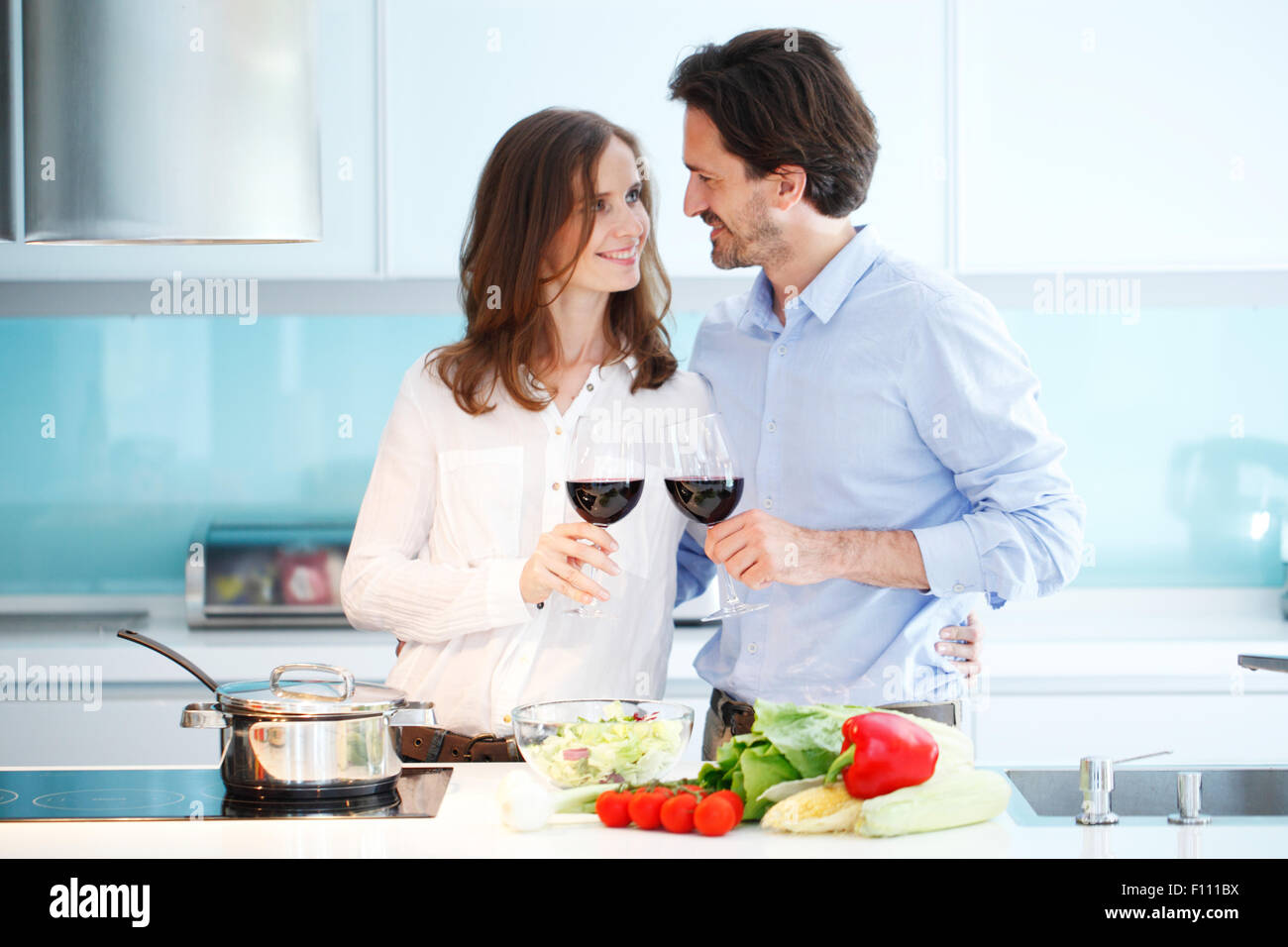 couple cooking dinner - Stock Image