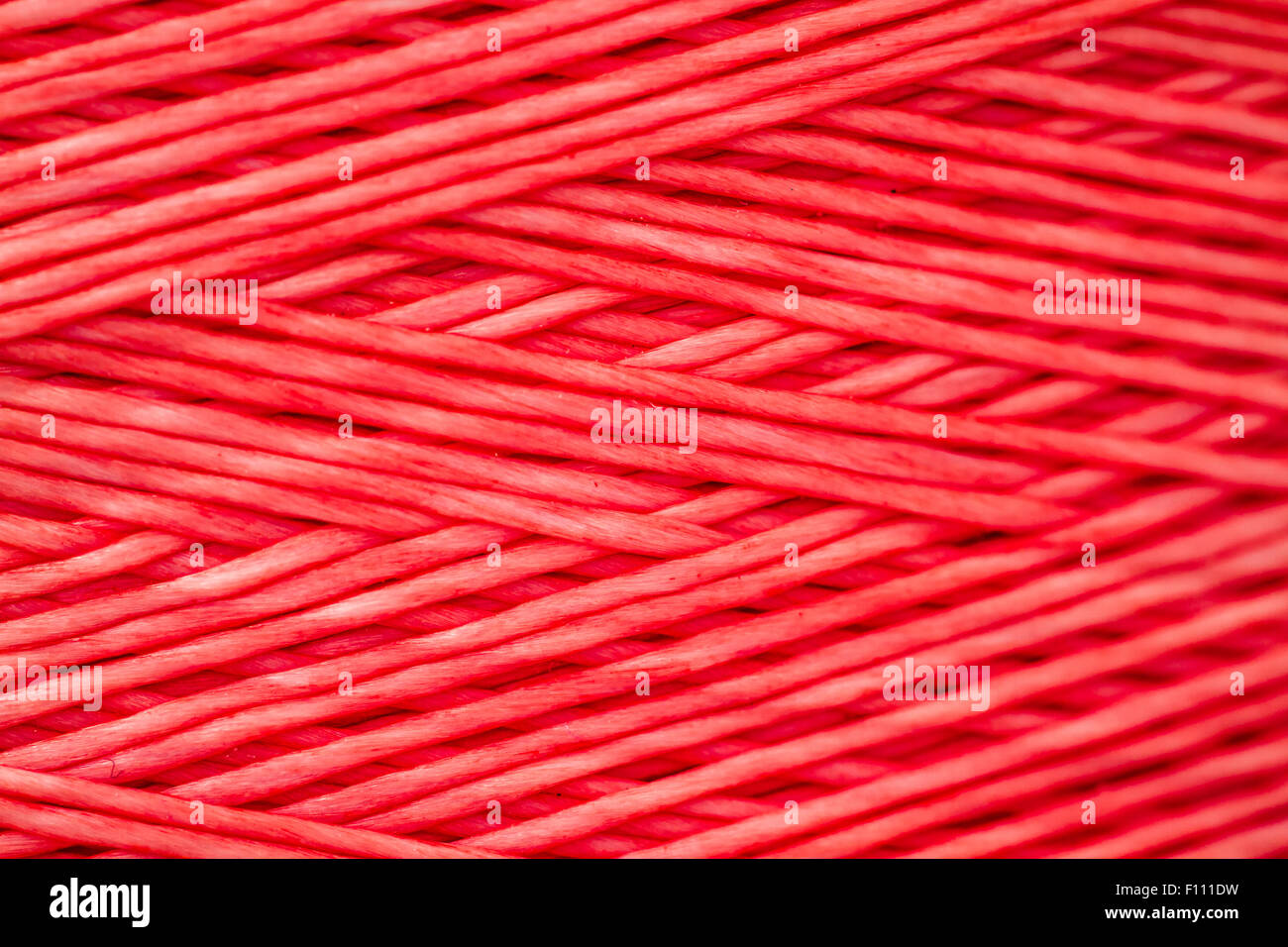 Close up of synthetic colored thread, texture and background - Stock Image