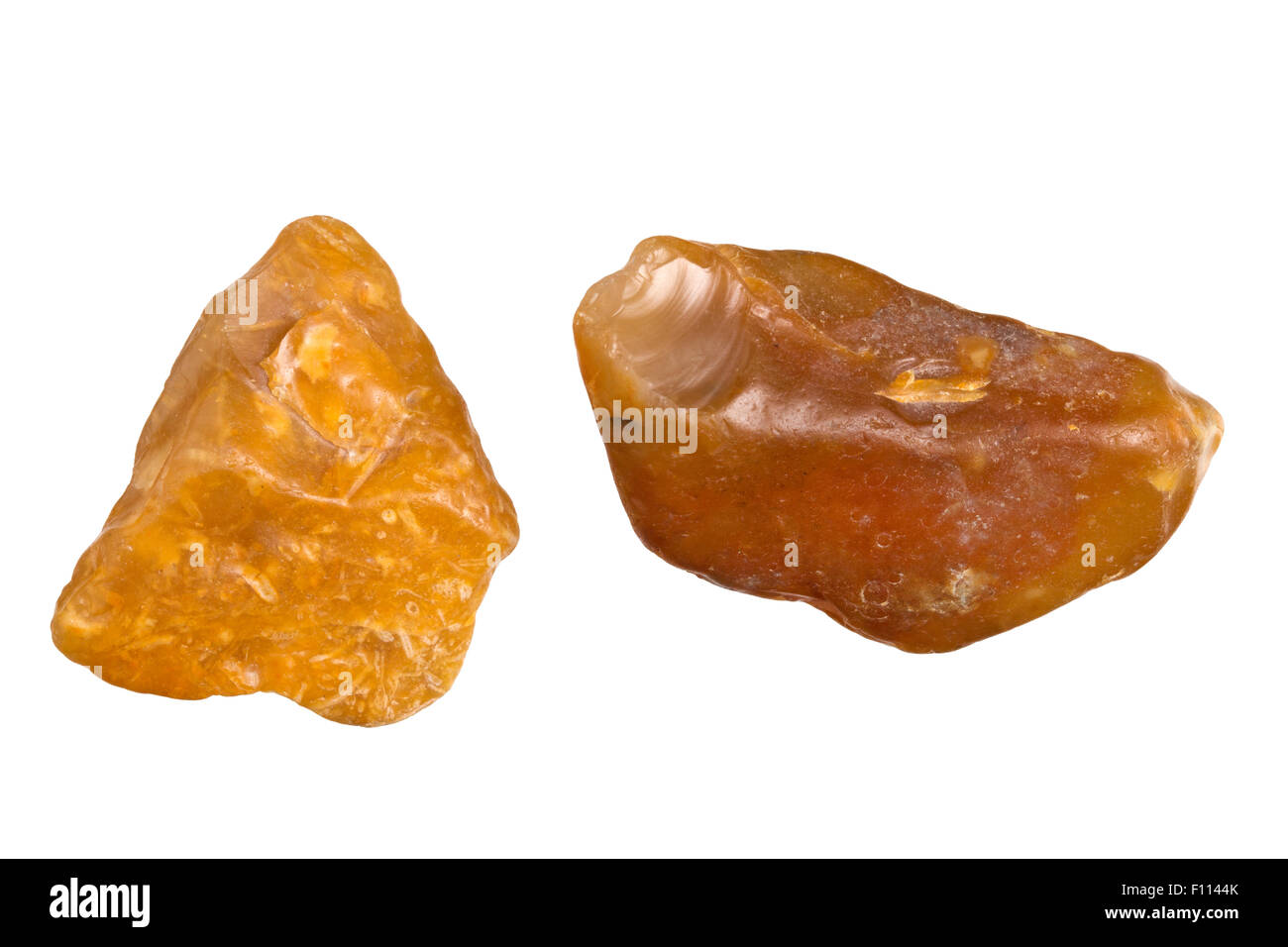 Two pieces of flint isolated on white from the Baltic Sea beach at Voderup Klint on the island of Aero, Denmark - Stock Image