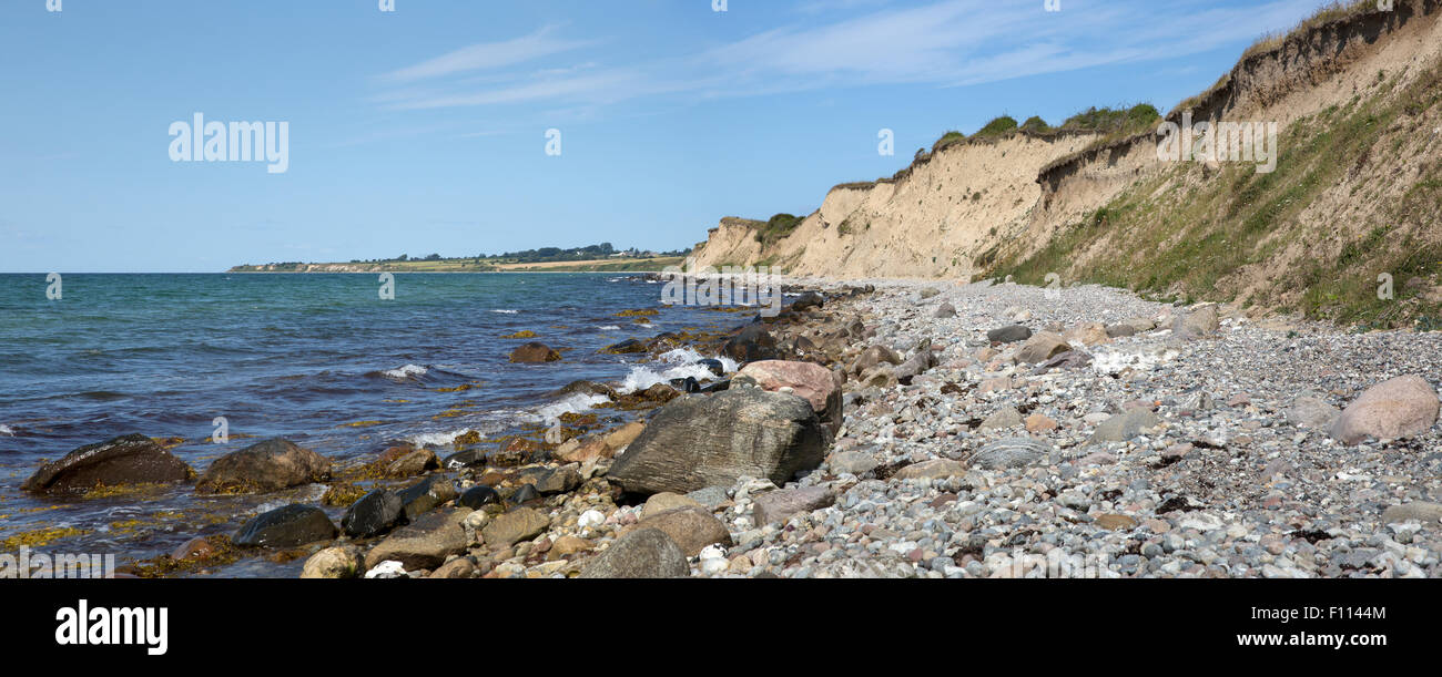 Panoramic view of the rocky beach and moraine cliffs at Voderup Klint on the island of Aero, Denmark - Stock Image